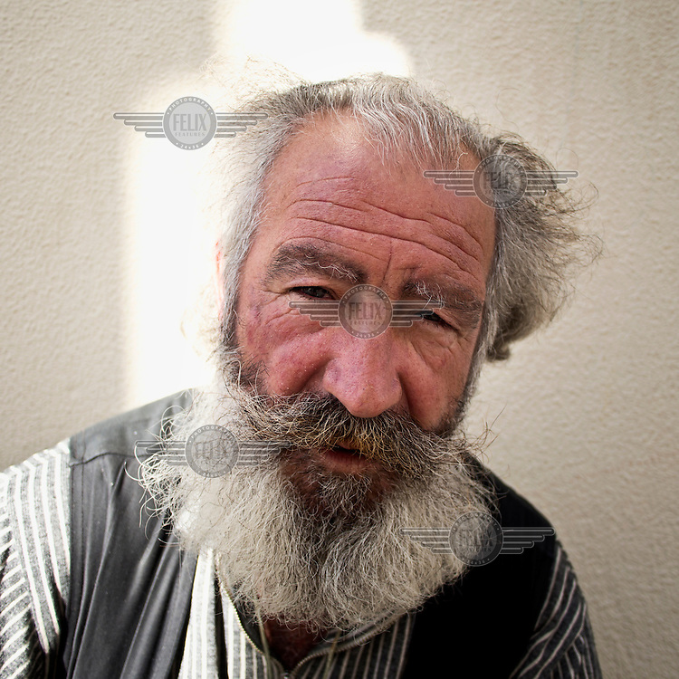 A portrait of a pilgrim begging on the street collecting money for his trip to Santiago.