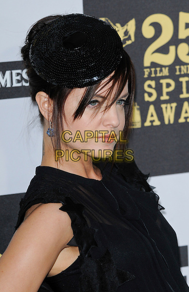 MENA SUVARI.The 25th Annual Film Independent Spirit Awards at the LA Live Event Deck in Los Angeles, California, USA..March 5th, 2010  .headshot portrait hat sequined sequins beret fringe hair over face black ruffle trim ruffle .CAP/ROT.©Lee Roth/Capital Pictures