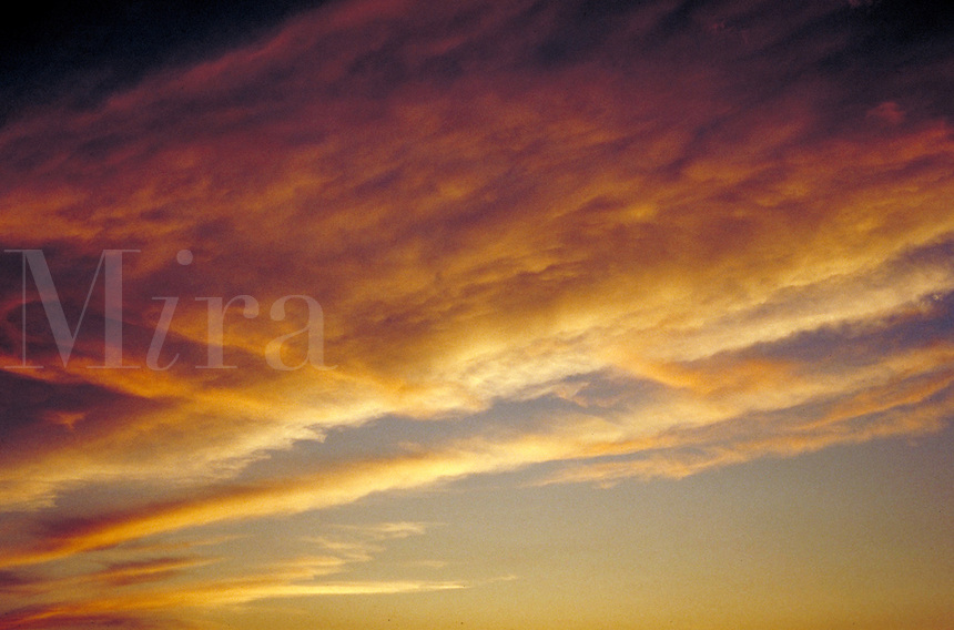 Colorful orange and pink clouds. Soft, airy, light, calm, serenity, billowy, storm front. Connotations - Religious, religion, serenity, peaceful, power, new beginnings, starting over.