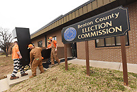 NWA Democrat-Gazette/FLIP PUTTHOFF<br />Inmates from the Benton County Jail including Mark Sharp (left) move desks Tuesday Jan. 2 2018 from the Benton County Election Commission office in Bentonville. The office is relocating to 2113 W. Walnut St. in Rogers, the former Kmart location.
