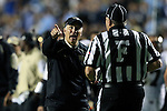 17 October 2015: Wake Forest head coach Dave Clawson (left) tries to get Field Judge Harry Tyson (F) watch a replay on the scoreboard. The University of North Carolina Tar Heels hosted the Wake Foresst University Demon Deacons at Kenan Memorial Stadium in Chapel Hill, North Carolina in a 2015 NCAA Division I College Football game. UNC won the game 50-14.
