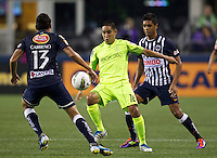 David Estrada, center, of the Seattle Sounders FC gets control of the ball between Darío Carreño, left, and Sergio Santana of CF Monterrey during a CONCACAF Champions League match at CenturyLink Field in Seattle Tuesday Oct. 18, 2011. CF Monterrey won the game 2-1.