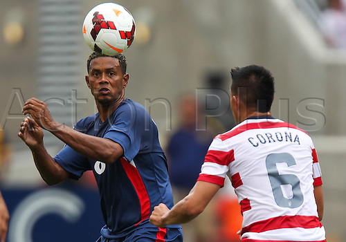 13.07.2013. Sandy, Utah, USA.Cuba midfielder Jaine Colome (8) looks to head the ball in front of US Men's National midfielder Joe Corona (6) during the CONCACAF Gold Cup soccer match between USA Men's National team and Cuba at Rio Tinto Stadium in Sandy, UT. USA.