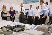 United States President Barack Obama (C) tours the The Federal Highway Administration's Turner-Fairbank Highway Research Center July 15, 2014 in McLean, Virginia. According to the Department of Transportation, the center is home to '20 laboratories, data centers, and support facilities, and conducts applied and exploratory advanced research in vehicle-highway interaction, nanotechnology, and a host of other types of transportation research in safety, pavements, highway structures and bridges, human-centered systems, operations and intelligent transportation systems, and materials.' <br /> Credit: Chip Somodevilla / Pool via CNP