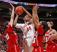 Ohio State Buckeyes guard Ameryst Alston (14) goes up for two against Nebraska Cornhuskers guard Rachel Theriot (33) and Nebraska Cornhuskers guard Brandi Jeffery (13) in first half action at Value City Arena on February 20,  2014. (Chris Russell/Dispatch Photo)