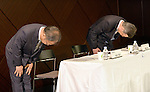 May 14, 2013, Tokyo, Japan - Takashi Okuda, left, outgoing president of Japan's Sharp Corp., and his successor Kozo Takahashi take deep bows at the start of a news conference in Tokyo on Tuesday, May 14, 2013. Takahashi, currently an executive vice president, will become its president and CEO as of June 25 in a reshuffle to help restore profitability after reporting a record loss of $5.4 billion in the fiscal year that ended in March. (Photo by Natsuki Sakai/AFLO)