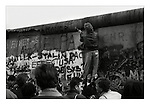 """Souvenir hunters attack the more fragile top of the """"Stützwandelement UL 12.11"""" (retaining wall element UL 12.11) or fourth-generation Berlin Wall (1975-80) from the West Berlin side, November 1989. 45,000 sections of reinforced concrete (12ft high by 4ft wide) were used to build this final version of the 95 mile long wall. Photograph copyright Graham Harrison."""