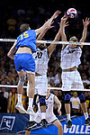 LOS ANGELES - MAY 5:  Josh Tuaniga #10 and Simon Anderson #13 of the Long Beach State 49ers defend against the spike by Jake Arnitz #15 of the UCLA Bruins during the Division 1 Men's Volleyball Championship on May 5, 2018 at Pauley Pavilion in Los Angeles, California. The Long Beach State 49ers defeated the UCLA Bruins 3-2. (Photo by John W. McDonough/NCAA Photos via Getty Images)