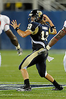 11 September 2010:  FIU quarterback Wesley Carroll (13) passes for a touchdown in the first quarter as the Rutgers Scarlet Knights defeated the FIU Golden Panthers, 19-14, at FIU Stadium in Miami, Florida.
