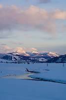 Lamar River winds away from the Beartooth Mountains at the end of a winter day in the Lamar Valley-Yellowstone NP