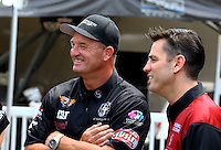 Apr 25, 2014; Baytown, TX, USA; NHRA top fuel dragster driver Bob Vandergriff Jr (left) with Larry Dixon during qualifying for the Spring Nationals at Royal Purple Raceway. Mandatory Credit: Mark J. Rebilas-