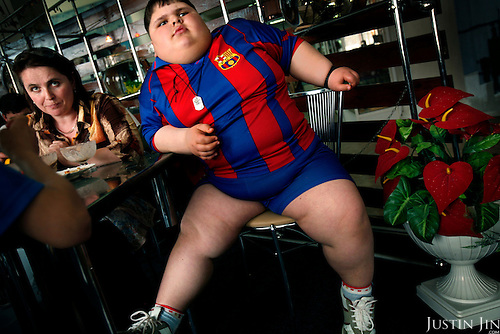 Dzhambulat Khotokhov, 6, one of the fattest boys in the world, enjoys a meal at a restaurant with his mother in Nal'chik, in southern Russia. Now 1.4 metres tall and weighing about 100 kg, Khotokhov has grabbed world attention as the biggest kid in the world since he was three. .Khotokhov lives with his mother Neyla and his brother, 14-year-old Mukha. .