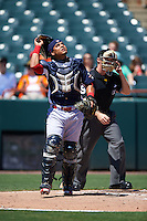 Reading Fightin Phils catcher Rene Garcia (6) watches a pop up in froth of umpire Junior Valentine during a game against the Bowie Baysox on July 22, 2015 at Prince George's Stadium in Bowie, Maryland.  Bowie defeated Reading 6-4.  (Mike Janes/Four Seam Images)