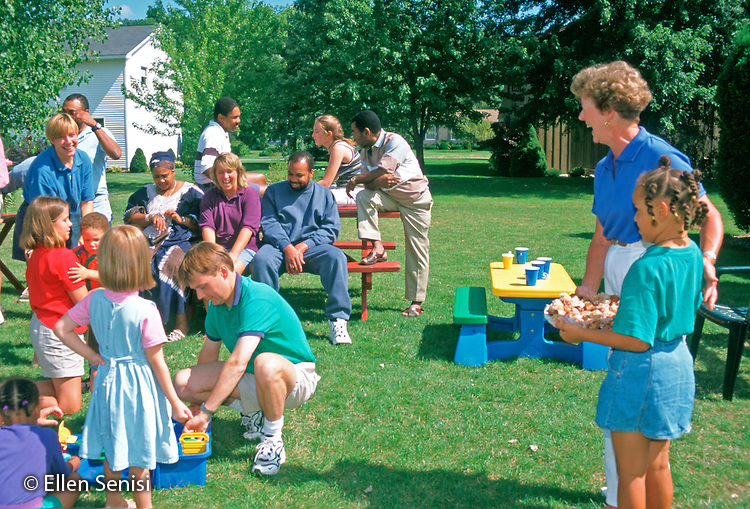 MR/ Cortland, New York.Girl (6, Jamaican-American/ Caucasian) with grandmother prepares to hand out dessert she has made for guests at interracial family gathering..MR:WLA.PN#:22463       FC#:11726-00115.scan from slide.© Ellen B. Senisi