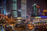 The Lujiazui Traffic Circle, with an elevated pedestrian promenade,  at night, Shanghai, China
