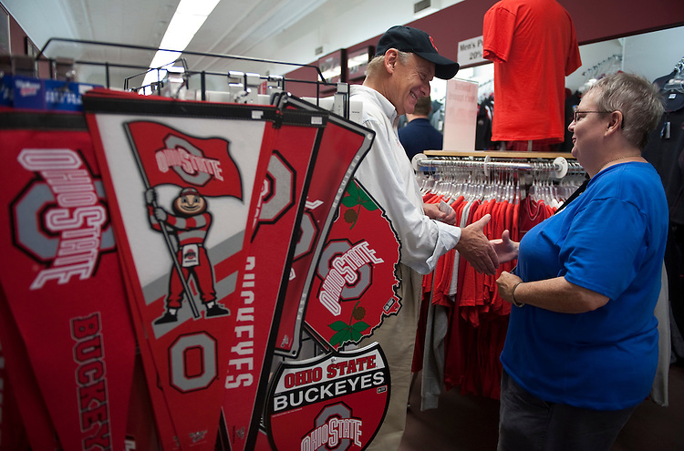 UNITED STATES - AUGUST 14: Ohio Democratic candidate for U.S. Senate Lt. Gov. Lee Fisher shakes hands with Mary Stevens inside the Buckeye Spirit store in Bellefontaine, Ohio, during his visit to the 11th Annual Hot Summer Cruise-In event on Saturday, Aug. 14, 2010. (Photo By Bill Clark/Roll Call via Getty Images)