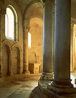 Morning light in the sanctuary of the Abbazia di Sant'Antimo, a medieval abbey under the forested hills of the Val D'Orcia at Castelnuovo dell'Abate