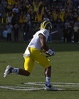 Michigan defensive back Raymon Taylor scores on a 63-yard interception return for a touchdown.  The Michigan Wolverines defeated the Purdue Boilermakers 44-13 on October 6, 2012 at Ross-Ade Stadium in West Lafayette, Indiana.