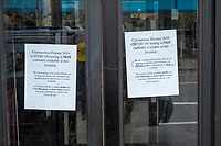 """A sign reads """"Coronavirus Diseas 2019 (COVID-19) testing is NOT currently available at this location"""" on the door of a CVS pharmacy in Belmont, Massachusetts, on Fri., March 20, 2020. The United States has experienced a shortage of testkits in the early days of the coronavirus COVID-19 global pandemic."""