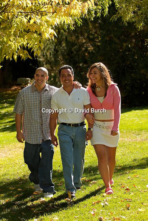 Hispanic man walking with his children