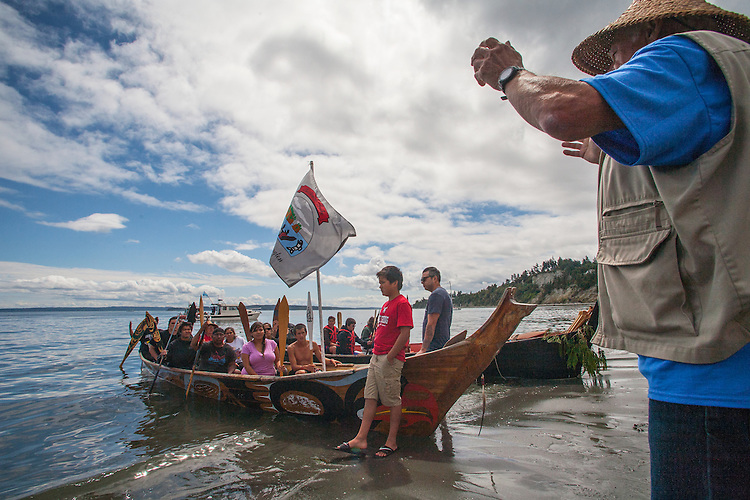 Canoe Journey, Paddle to Nisqually, 2016, Marlin Holden, Executive Director of the Jamestown S'Kallam Tribe welcomes Quinault, La Push canoes,  landing, Port Townsend, Fort Worden, en route to Olympia, Washington State, Olympic Peninsula, Puget Sound, Salish Sea, USA,
