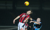 Andy Parrish of Morecambe & Garry Thompson of Wycombe Wanderers go up for the ball during the Sky Bet League 2 match between Wycombe Wanderers and Morecambe at Adams Park, High Wycombe, England on 2 January 2016. Photo by Andy Rowland / PRiME Media Images