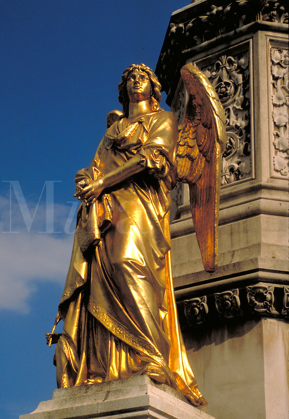 A golden angel looks up to heaven outside St. Stephen's Cathedral in Zagreb. Yugoslavia. Angels are bodiless, immortal spirits accepted in the traditional beliefs of many religions. Zagreb, Croatia Cathedral.