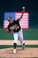OAKLAND, CA - Barry Zito of the Oakland Athletics pitches during a game at the Oakland Coliseum in Oakland, California in 2002. Photo by Brad Mangin