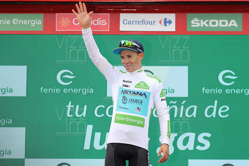ESPAÑA, 12-09-2019: Miguel Angel Lopez (COL - ASTANA) celebra con la camiseta blanca como líder como mejor joven después de la etapa 18, hoy, 12 de septiembre de 2019, que se corrió entre Comunidad de Madrid. Colmenar Viejo y Becerril de la Sierra con una distancia de 177,5 km como parte de La Vuelta a España 2019 que se disputa entre el 24/08 y el 15/09/2019 en territorio español. / Miguel Angel Lopez (COL - ASTANA) celebrates with the white best young rider jersey after stage 18 today, September 12, 2019, from Comunidad de Madrid. Colmenar Viejo to Becerril de la Sierra with a distance of 177,5 km as part of Tour of Spain 2019 which takes place between 08/24 and 09/15/2019 in Spain.  Photo: VizzorImage / Luis Angel Gomez / ASO<br /> VizzorImage PROVIDES THE ACCESS TO THIS PHOTOGRAPH ONLY AS A PRESS AND EDITORIAL SERVICE AND NOT IS THE OWNER OF COPYRIGHT; ANOTHER USE HAVE ADDITIONAL PERMITS AND IS  REPONSABILITY OF THE END USER