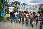 Indigenous people march through the streets of Atalaia do Norte in Brazil's Amazon region on March 27, 2019, protesting a central government plan to turn control of health care over to municipalities, in effect destroying a federal program of indigenous health care. Indian rights activists are worried that the government of President Jair Bolsonaro is reducing or eliminating protections for the country's indigenous people.