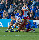 9th February 2019, Halliwell Jones Stadium, Warrington, England; Betfred Super League rugby, Warrington Wolves versus Hull KR; Craig Hall is tackled by Bryson Goodwin and Harvey Livett