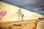 Sirte, LIBYA: Monday 11th October 2011:..A rebel fighters climbs a ladder to look out at Gadaffi loyalist forces positions during fierce fighting in the the Libyan city of Sirte. Once rebels capture Sirte,  Gaddafi's hometown, the National Transitional Council (NTC) say they will declare national liberation, even if Col Gaddafi remains at large...Ayman Oghanna