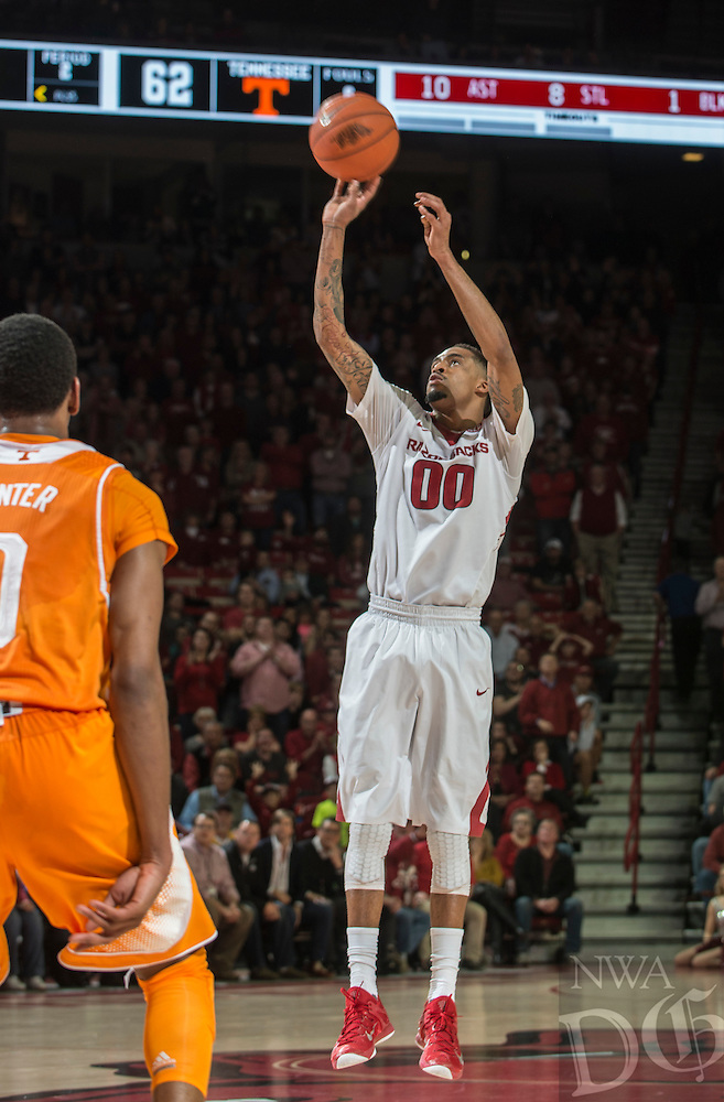 NWA Democrat-Gazette/ANTHONY REYES • @NWATONYR<br /> Rashad Madden, Arkansas senior, shoots for three against Tennessee Tuesday, Jan. 27, 2015 in Bud Walton Arena in Fayetteville. The Razorbacks won 69-64.