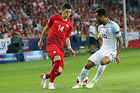Dawid Kownacki of Poland and Lewis Baker of England during England Under-21 vs Poland Under-21, UEFA European Under-21 Championship Football at The Kolporter Arena on 22nd June 2017
