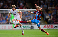 Peterborough United's Mark O'Hara vies for possession with Scunthorpe United's Matthew Lund<br /> <br /> Photographer Chris Vaughan/CameraSport<br /> <br /> The EFL Sky Bet League One - Scunthorpe United v Peterborough United - Saturday 13th October 2018 - Glanford Park - Scunthorpe<br /> <br /> World Copyright &copy; 2018 CameraSport. All rights reserved. 43 Linden Ave. Countesthorpe. Leicester. England. LE8 5PG - Tel: +44 (0) 116 277 4147 - admin@camerasport.com - www.camerasport.com