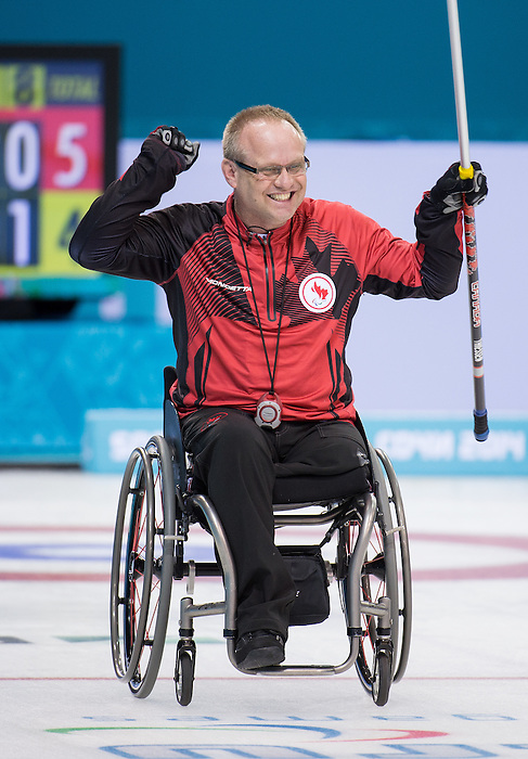 Sochi, RUSSIA - Mar 15 2014 - Dennis Thiessen celebrates advancing to the gold medal match in Wheelchair Curling at the 2014 Paralympic Winter Games in Sochi, Russia.  (Photo: Matthew Murnaghan/Canadian Paralympic Committee)