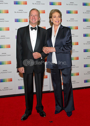 David Bohnett and Julie Andrews arrive for the formal Artist's Dinner honoring the recipients of the 38th Annual Kennedy Center Honors hosted by United States Secretary of State John F. Kerry at the U.S. Department of State in Washington, D.C. on Saturday, December 5, 2015. The 2015 honorees are: singer-songwriter Carole King, filmmaker George Lucas, actress and singer Rita Moreno, conductor Seiji Ozawa, and actress and Broadway star Cicely Tyson.<br /> Credit: Ron Sachs / Pool via CNP/MediaPunch