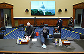 Dr. Anthony Fauci, Director, National Institute for Allergy and Infectious Diseases, National Institutes of Health, reads papers as a worker cleans a table prior to a House Committee on Energy and Commerce hearing on the Trump Administration's Response to the COVID-19 Pandemic, on Capitol Hill in Washington, DC on Tuesday, June 23, 2020. <br /> Credit: Kevin Dietsch / Pool via CNP