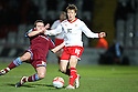 Luke Freeman of Stevenage (on loan from Arsenal) tackled by Jose Baxter of Tranmere. - Stevenage v Tranmere Rovers - npower League 1 - Lamex Stadium, Stevenage - 17th December 2011  .© Kevin Coleman 2011 ... ....  ...  . .