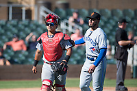 Surprise Saguaros catcher Jeremy Martinez (4), of the St. Louis Cardinals organization, and starting pitcher Shawn Morimando (53), of the Toronto Blue Jays organization, walk off the field between innings of an Arizona Fall League game against the Salt River Rafters at Salt River Fields at Talking Stick on November 5, 2018 in Scottsdale, Arizona. Salt River defeated Surprise 4-3 . (Zachary Lucy/Four Seam Images)