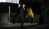 United States President Barack Obama waves to the photographers as he leaves the residence to board Marine One to depart the White House March 19, 2013 in Washington, DC. Obama will travel to Tel Aviv,Israel, the Palestinian Authority, and Jordan.<br /> Credit: Olivier Douliery / Pool via CNP