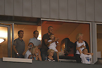 David Beckham applauds while holding his son Romeo as family and friends watch the LA Galaxy of MLS defeat CF Pachuca of the Mexican First Division 2-1 during an opening round SuperLiga match at the Home Depot Center, Carson, CA, on July 24, 2007.