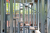 """8/2/2013. Stairway. The steel framing has been completed over the foundation on the Begley's new home and plumbing installation has begun. Steel, while not a common material for residential framing, is 94% recyclable. Ed Begley Jr. (noted actor and environmentalist) and his wife Rachelle Carson-Begley are building their new home under LEED Platinum Certified standards in an attempt to become one of North America's greenest, most sustainable home. It is also being filmed for their web series """"On Begley Street."""" Studio City, CA., US"""