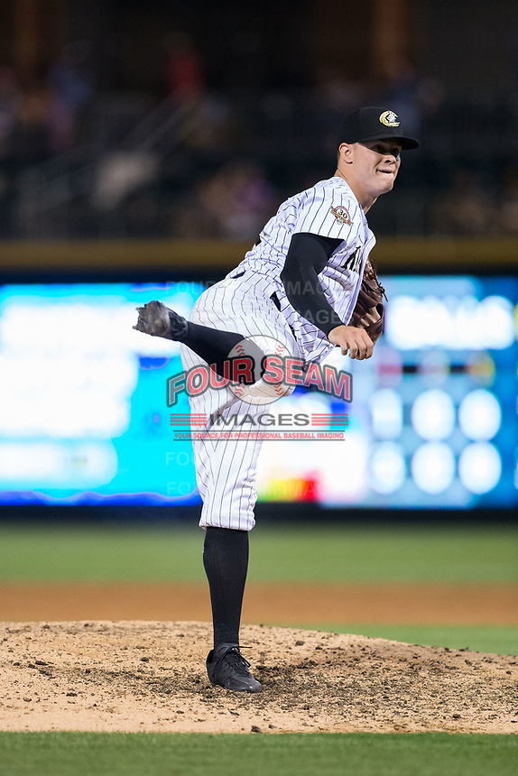 Charlotte Knights relief pitcher Zack Burdi (34) follows through on his delivery against the Durham Bulls at BB&T BallPark on May 15, 2017 in Charlotte, North Carolina. The Knights defeated the Bulls 6-4.  (Brian Westerholt/Four Seam Images)