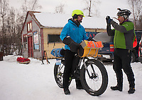 Competitors chat before beginning the 200-mile Iditasport Human Powered Race in Knik, Alaska. The 2014 event is a revival of the legendary 1980's race, which was the first of its kind to put foot and bicycle power to the test against a trail normally only traversed by dogsled or snowmachine. The original competition paved the way for other endurance races in the far north and spurred a number of innovations in outdoor equipment, including the now-ubiquitous fat tire bicycle.