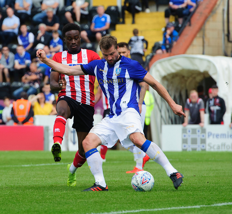 Sheffield Wednesday's Julian Borner under pressure from Lincoln City's Jordan Adebayo-Smith<br /> <br /> Photographer Chris Vaughan/CameraSport<br /> <br /> Football Pre-Season Friendly - Lincoln City v Sheffield Wednesday - Saturday July 13th 2019 - Sincil Bank - Lincoln<br /> <br /> World Copyright © 2019 CameraSport. All rights reserved. 43 Linden Ave. Countesthorpe. Leicester. England. LE8 5PG - Tel: +44 (0) 116 277 4147 - admin@camerasport.com - www.camerasport.com