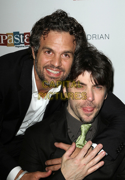 MARK RUFFLO & CHRISTOPHER THORNTON .Special event for the release of Sympathy for Delicious Held At The Sky Bar, Mondrian Hotel, West Hollywood, California, USA, 27th April 2011..half length  black suit green tie beard facial hair  hugging hug .CAP/ADM/KB.©Kevan Brooks/AdMedia/Capital Pictures.