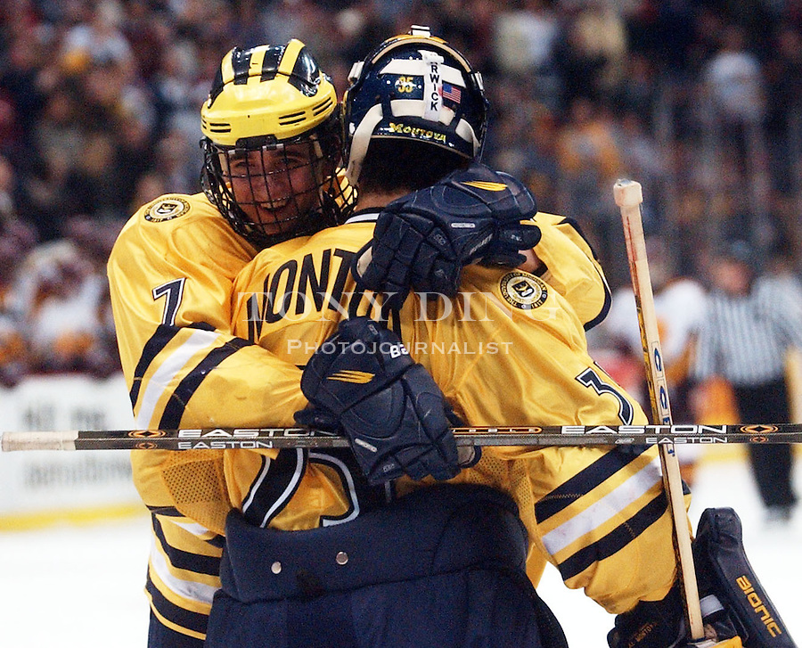 Michigan freshman goaltender Al Montoya (35) gets a heart felt hug from freshman defender Danny Richmond (7) after the Wolverines beat out Ferris State 4-3 in the CCHA Super6 Championship game on Friday, March 21, 2003 at Joe Louis Arena in Detroit, Mich (Tony Ding/Daily).