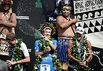 KONA, HAWAII - OCTOBER 14:  Patrick Lange of Germany celebrates his overall victory and New Course Record of 8:01.40 with 2nd place Lionel Sanders (right) and 3rd Place David McNamee of Great Britain during the 2017 IRONMAN World Championships on October 12, 2017 in Kona, Hawaii. (Photo by Donald Miralle for IRONMAN)