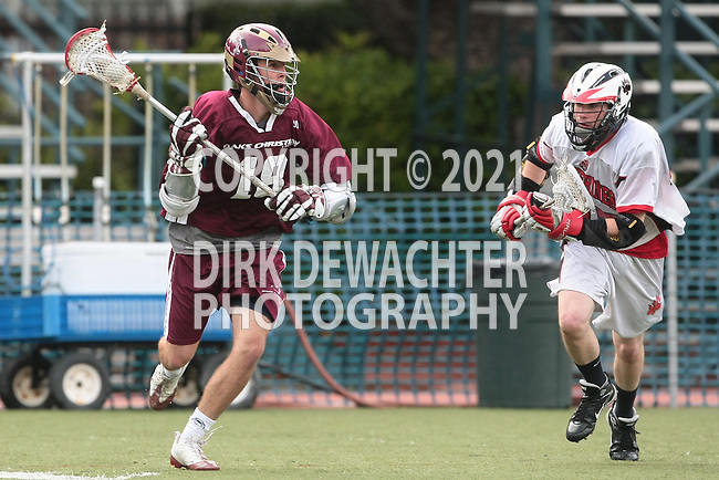Los Angeles, CA 04/20/10 -  Robbie Thomson (Oaks Christian # 18) and Justin Shabahang (Harvard Westlake # 25) in action during the Oaks Christian-Harvard Westlake Boys Varsity Lacrosse game at Harvard-Westlake High School.  The Harvard Westlake Wolverines defeated the Oaks Christian Lions 13-9.
